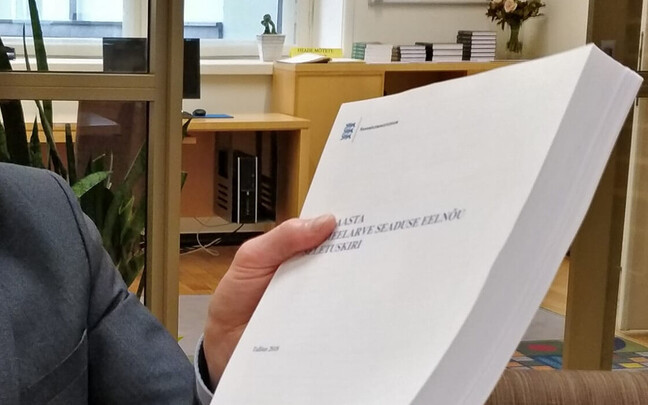 MP Aivar Sõerd (Reform) with a copy of the state budget bill.