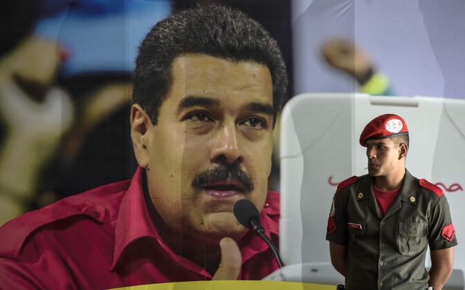 Venezuela sõdur president Maduro plakati ees.
