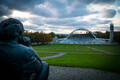 The statue of Gustav Ernesaks overlooks ongoing renovations at the Tallinn Song Festival Grounds, where the Gulf of Finland can currently be seen through the arch. October 2018.