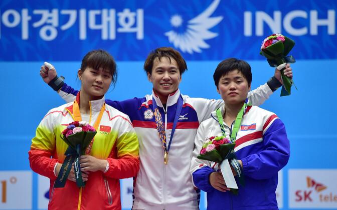 Lin Tzu-chi 2014. aasta Aasia mängudel pjedestaali kõrgeimal astmel.