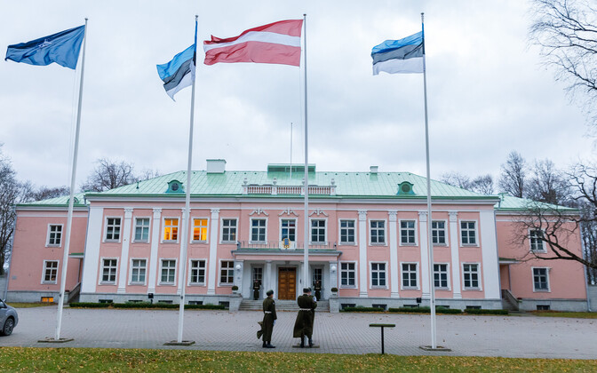 The Latvian flag flanked by those of Estonia in front of the Presidential Palace in Kadriorg, Tallinn.