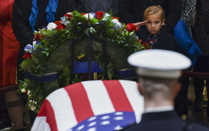 George Bush lies in state at the Capitol until Wednesday, when his funeral takes place.