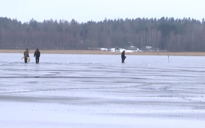 Fishermen on ice. Photo is illustrative.