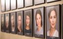 Töötajate fotod Vene teatri seinal.