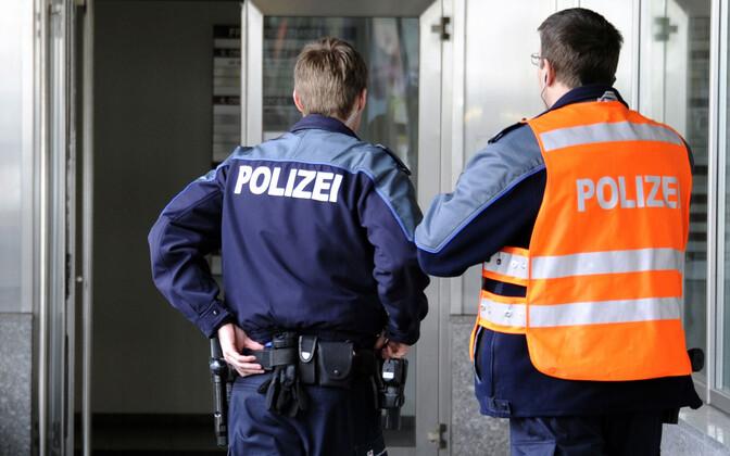 Šveitsi politsei.