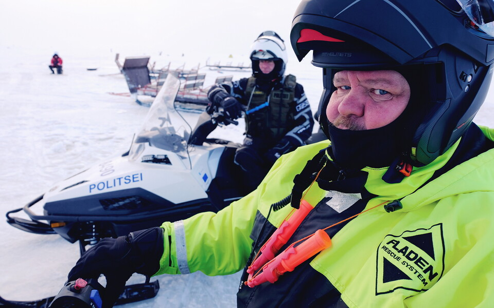 Senior Border Guard Officer Heiki Suomalainen and another border guard stop to check on ice fishermen on the frozen Lake Peipus on Friday. 18 January 2019.