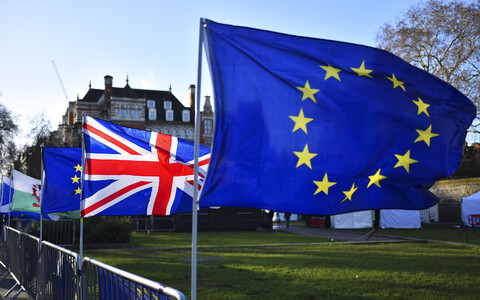 EU and UK flags.