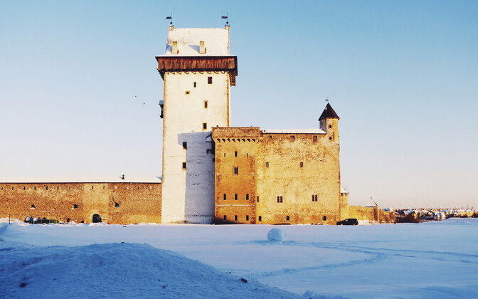Narva Castle, with part of Ivangorod Fortress and the town of Ivangorod on the opposite bank of the Narva River visible in the background. 31 January 2019.