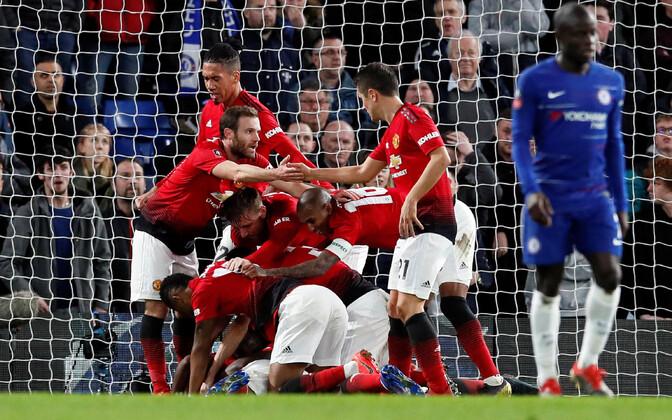 Manchester Unitedi mängijad väravat tähistamas