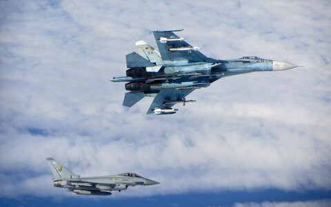 Typhoon fighter jet of the Royal Air Force intercepting a Russian Sukhoi Su-27. Image is illustrative