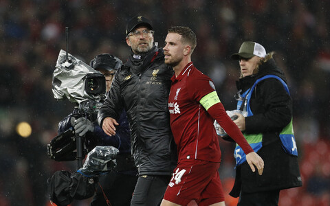 Jürgen Klopp ja Jordan Henderson