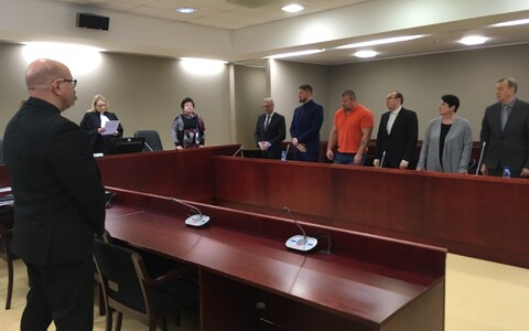 Artjom Suvorov (fifth from left in blue suit) in court.