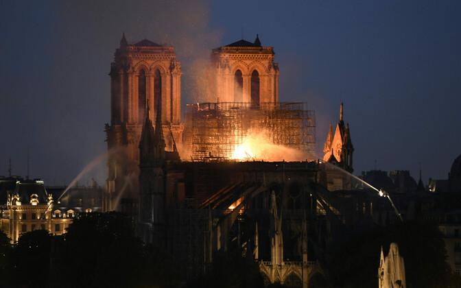 Paris fire brigades working to bring the fire under control.