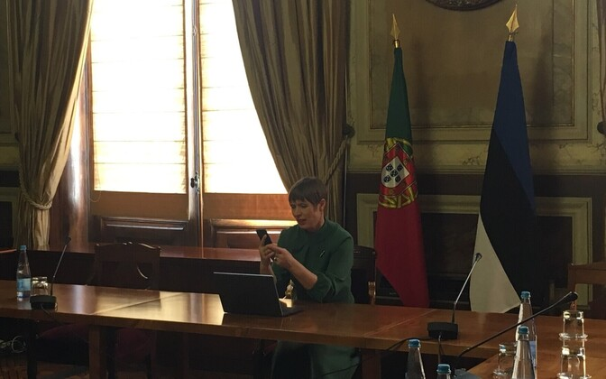 President Kersti Kaljulaid digitally signing the order while on a visit to Portugal.