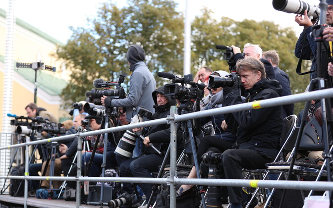 Journalists covering an event at Tallinn's Freedom Square.