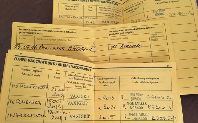 A paper vaccination record card.