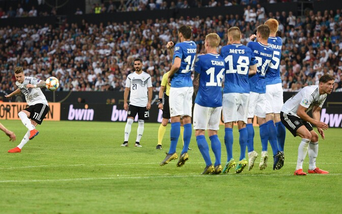 Marco Reus' (11) second goal of the night, and fifth for Germany, as his free kick sails over the Estonian wall.