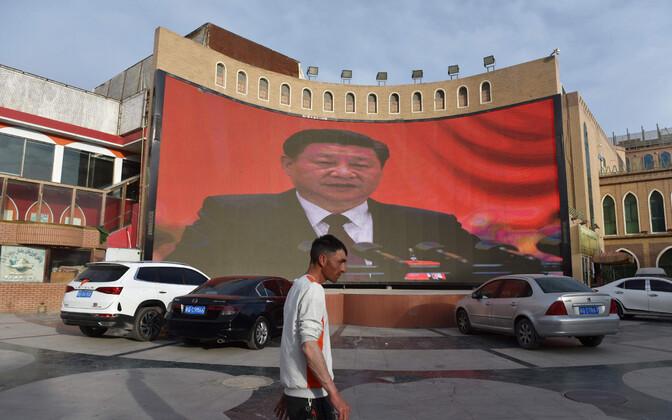 Hiina president Xi Jinping väliekraanil Kashgari linnas Xinjiangi provintsis.