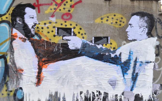 Salvinit ja Di Maiot kujutav seinamaaling Milanos.