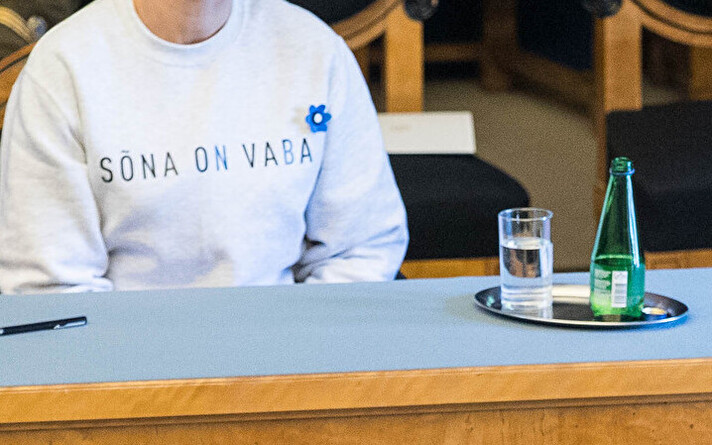 President Kersti Kaljulaid in the Riigikogu, wearing a sweatshirt that says