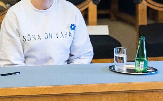 President Kersti Kaljulaid in the Riigikogu, wearing a sweatshirt that says