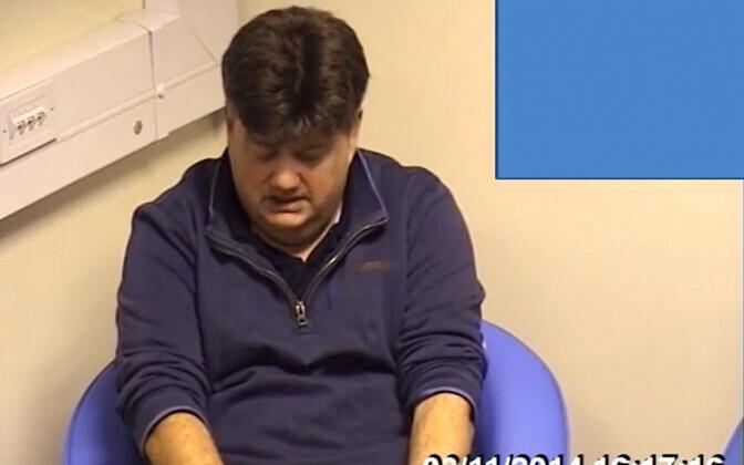 Sarilaimaja Carl Beech kohtuprotsessil videosilla ekraanil.