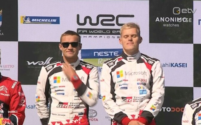 Ott Tänak (right) and co-driver Martin Järveoja on the podium in Finland on Sunday.