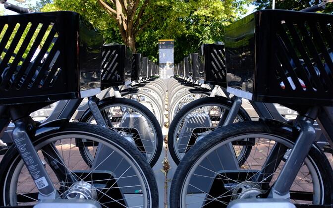 Electric bikes parked by Tartu Kaubamaja.