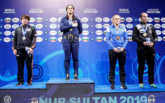 Epp Mäe (second from right) on the podium after winning bronze at the world championships.