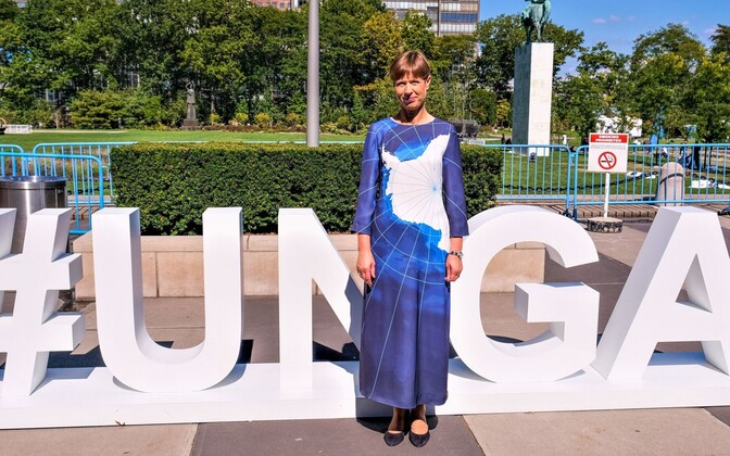 Kersti Kaljulaid at the United Nations, wearing a dress depicting Antarctica, which she says is a global thermostat that regulates the earth's climate, keeping it habitable.