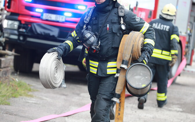 A rescuer in turnout gear participating in a rescue exercise.