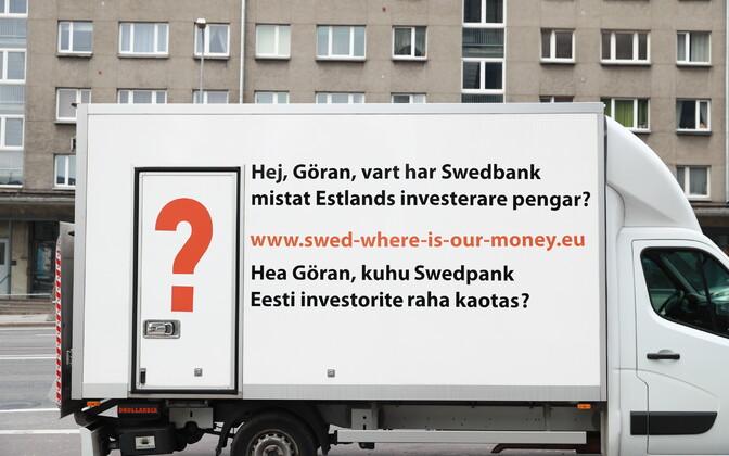 Protestors parked a van outside Swedbank's Tallinn head office Thursday.