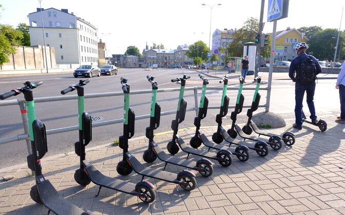 Bolt electric scooters parked outside of Tallinn Bus Station.