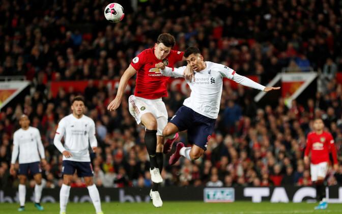 Harry Maguire (Manchester United) ja Roberto Firmino (Liverpool)