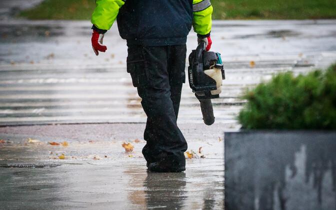 Man with leaf blower.