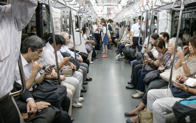 People on a train in Japan.