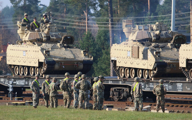 U.S. tanks and armored fighting vehicles arriving in Lithuania. Photo is illustrative.
