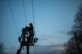 Электрики ликвидируют последствия шторма.