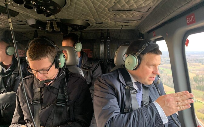 Prime Minister Jüri Ratas (Centre) flying over Võru County to inspect storm damage.