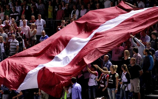 Oversized Latvian flag at a sporting event.