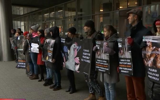 Protestors outside Tallinn's Kaubamaja department store.
