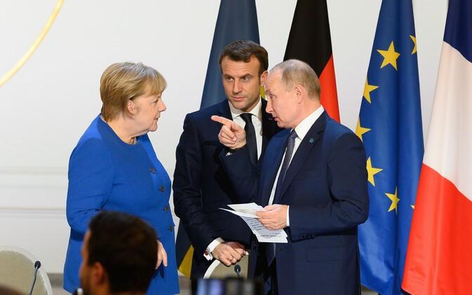 Merkel, Macron ja Putin Pariisi tippkohtumisel.
