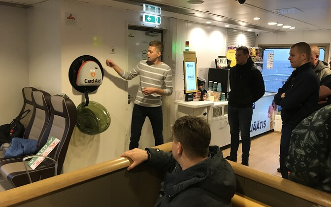 A new CardiAid AED being demonstrated on a TS Laevad ferry.