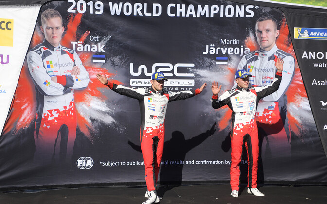 Ott Tänak (right) and Martin Järveoka after winning the world championship in Spain.