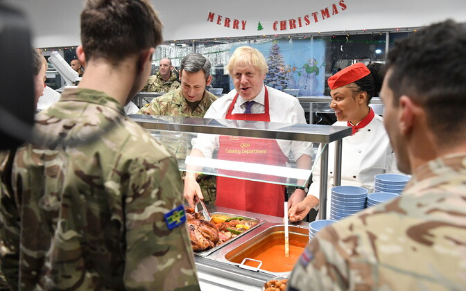 British Prime Minister Boris Johnson serving Christmas lunch to British troops at Tapa Army Base. December 21, 2019.