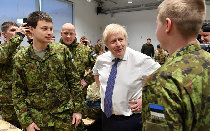 Boris Johnson chatting with Estonian Defence Forces members at Tapa base on Saturday.