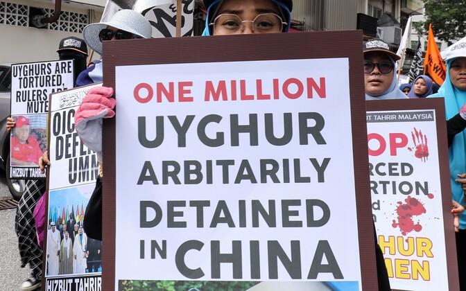 Uiguure toetav meeleavaldus Maiaisias.