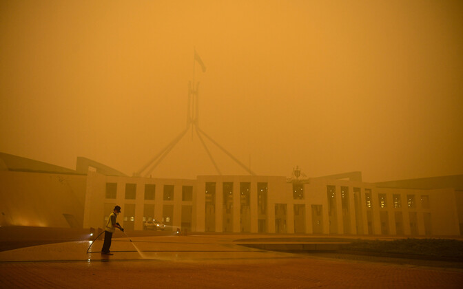 Australian Parliament Building in Canberra. The ashes from the fires have turned the sky yellow.