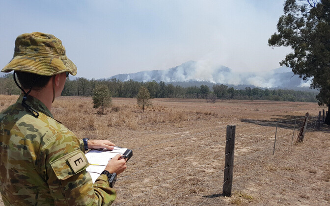Australian reservist monitoring a fire.
