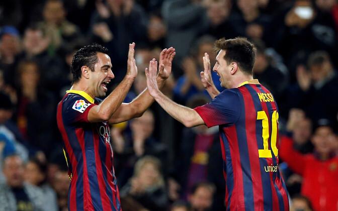 Xavi (vasakul) ja Lionel Messi